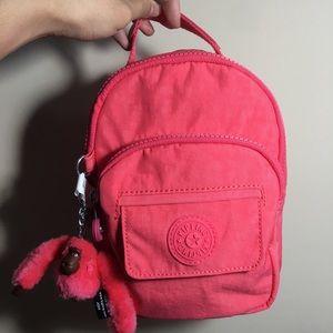 Kipling convertible mini backpack in Pink